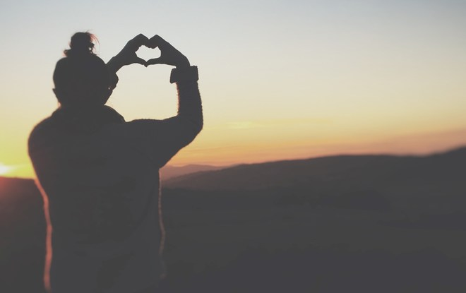 Image of woman making a heart with her hands